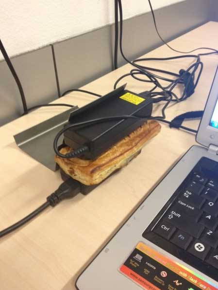 Sausage roll heated with laptop