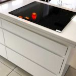 Electric hob above pan drawers