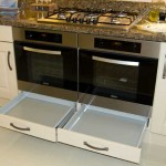 Built under oven housing drawers