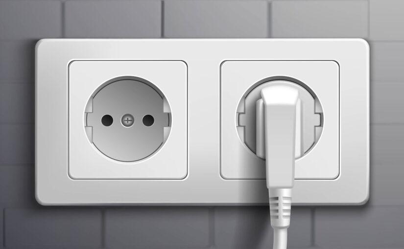Integrated fridge/freezer wall unit and power socket
