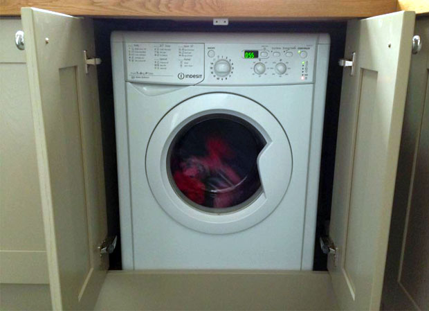 Integrated washing machine doors open