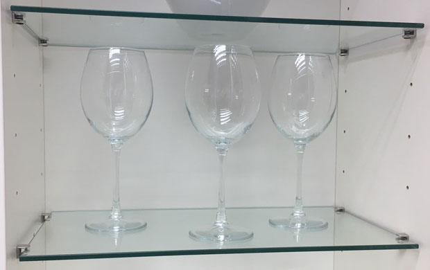 Glass shelf with glasses