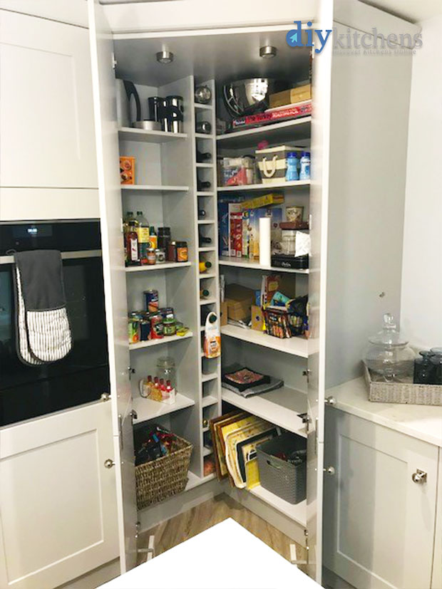 Walk in larder with plinth and filled with items
