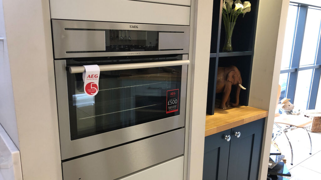 Compact oven with warming drawer